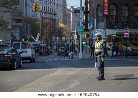 New York, United States of America - November 17, 2016: A black traffic cop regulating the traffic in Lower Manhattan district