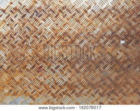 Rusty diamond metal plate texture and background . Rusted aluminium floor texture background.Abstract rusty metal surface.rusty steel plate texture background.Old Grungy and Dirty rusty metal sheet