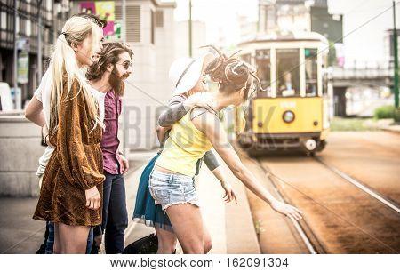Group of teens waiting the tram in Milan
