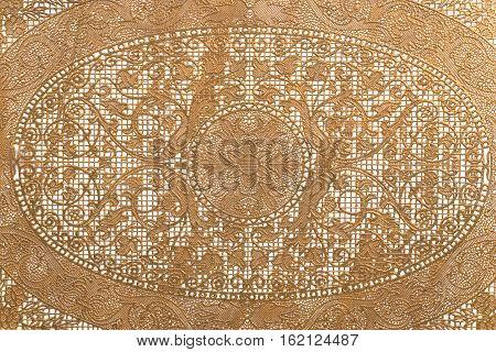 Floral lace background close up. Golden color.