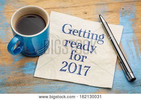 Getting ready for 2017 - handwriting on a napkin with a cup of espresso coffee
