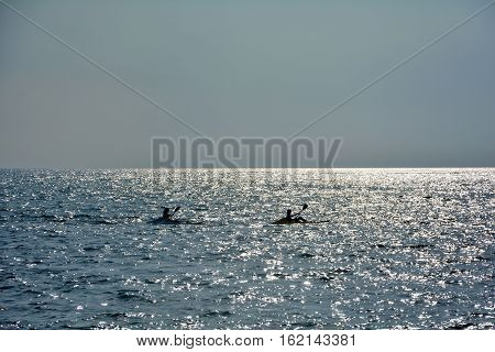 Two small boats in the sea at the sundown