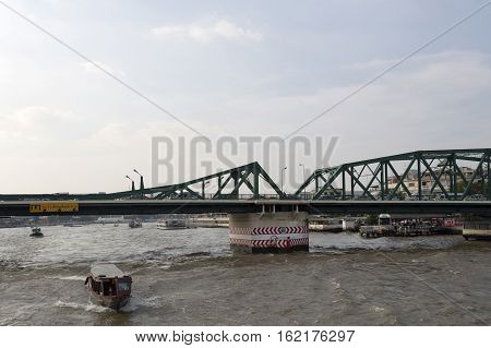 The Phra Phuttayotfa Bridge or the Memorial Bridge is a bascule bridge over the Chao Phraya River in Bangkok Thailand. The double-leaf bascule-type lifting mechanism is now disused.