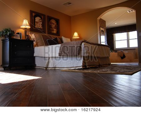 Luxury Bedroom with Hardwood Flooring