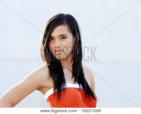 Attractive young woman swearing orange dress