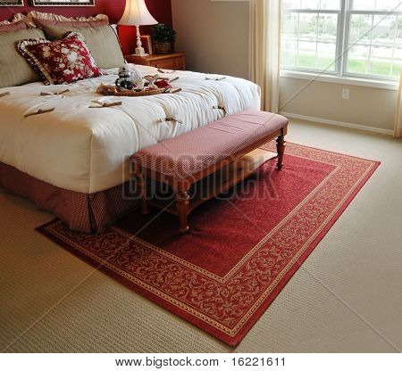 Traditional woven rug in beautiful bedroom