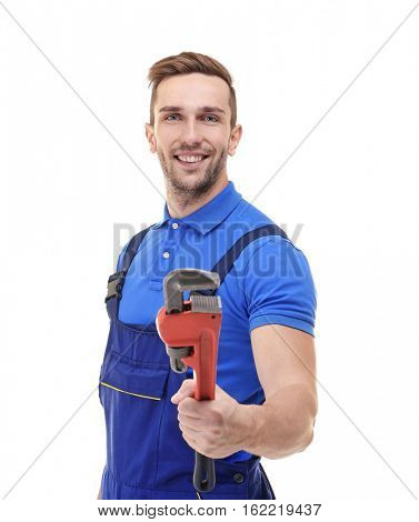 Plumber in blue uniform holding screw-wrench isolated on white