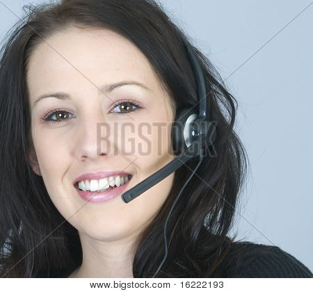 Attractive smiling woman talking on her cell phoneCustomer service representative using headset to talk on the phone