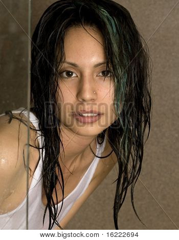 Artistic portrait of young model with damp hair.