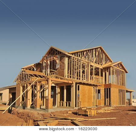 A new home being built with wood, trusses and supports