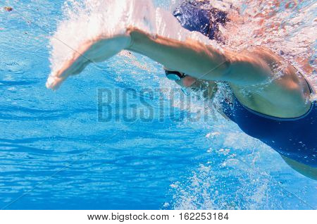 Underwater swimming stroke convenient copy space, toned image underwater, horizontal