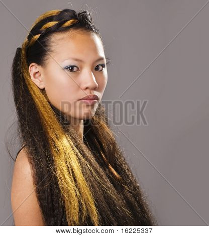 Asian beauty with long extensions in hair