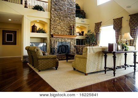 Beautiful large executive home living room area with lush polished hardwood flooring