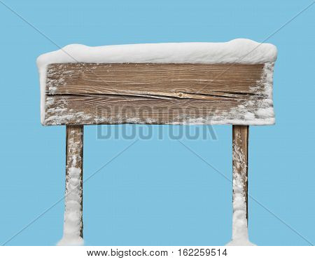 Wide wooden signpost with snow on it isolated on blue