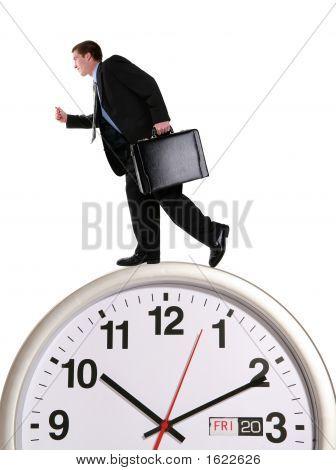 Business Man On Clock