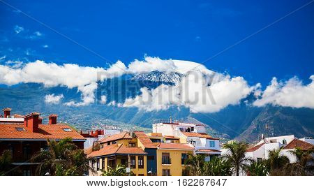 houses near the port of Puerto de la Cruz with the mount Teide in the background Tenerife Spain