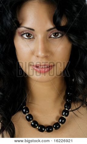 A stunningly beautiful young Hispanic woman looking sultry