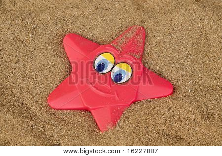 Colorful beach star shape smiling toy