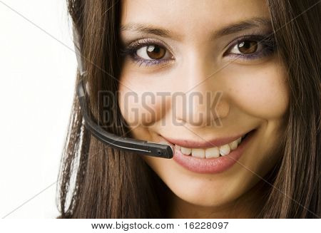 Cute smiling friendly faced woman wearing phone head set