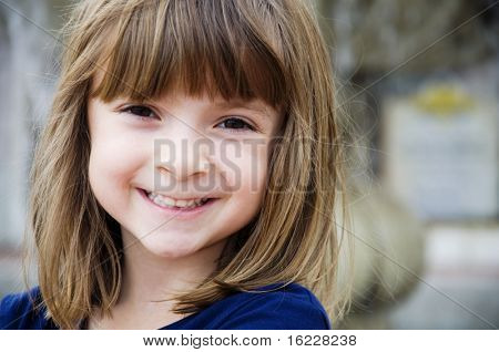 Portrait of a pretty little girl with bright smile