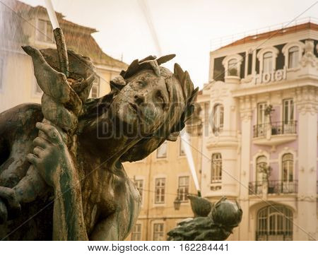 Mythical figure on a water fountain in Lisbon, Portugal
