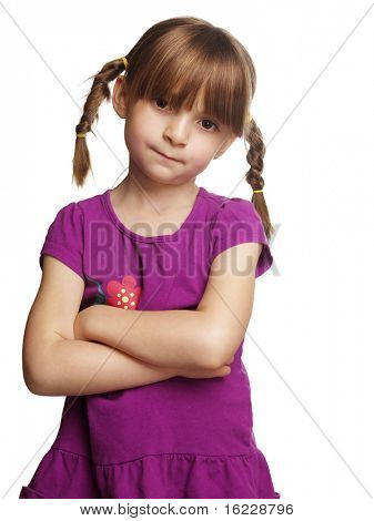Cute  little girl with braided pig tails and arms crossed with funny stern look on her face