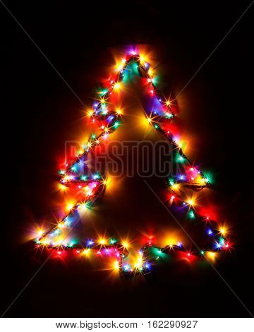 Christmas tree shape of multicolor garland lights