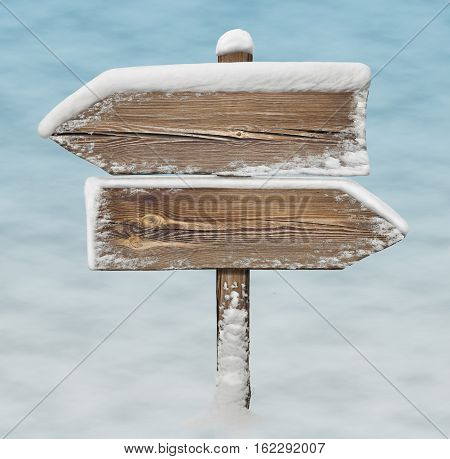Wooden Direction Sign With Snow And Snow Bg. Two_arrows-opposite_directions