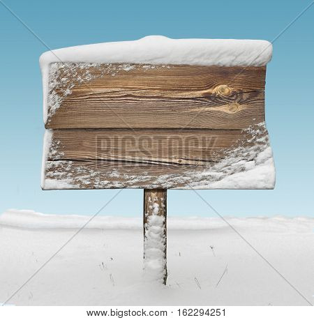 Wooden Signpost With Snow And Blue Sky