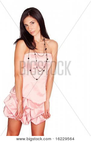 Pretty young woman wearing pink graduation party dress