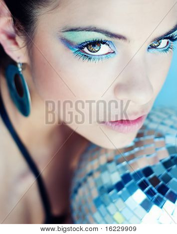 Beautiful disco diva futuristic club girl.  Focus on eyes with shallow depth of field