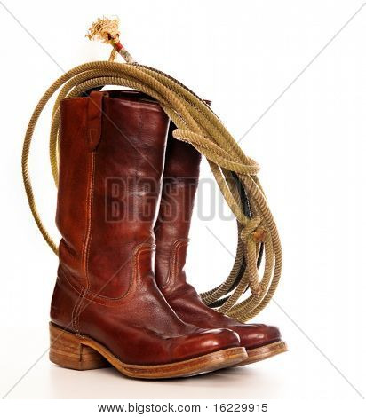 vertical image of a pair of brown cowboy boots and a Lasso on a white background