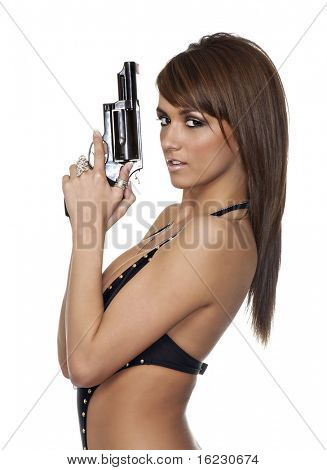 Young woman holding a gun on white background