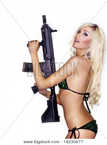 Beautiful sexy blond woman isolated holding army weapon