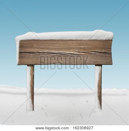 Wide Wooden Signpost With Less Snow And Blue Sky