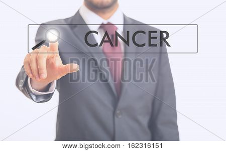 Man Pointing At Word Cancer