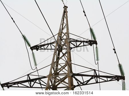 Air high voltage power line for power transmission by means of electric current. Steel poles, wires, insulators.