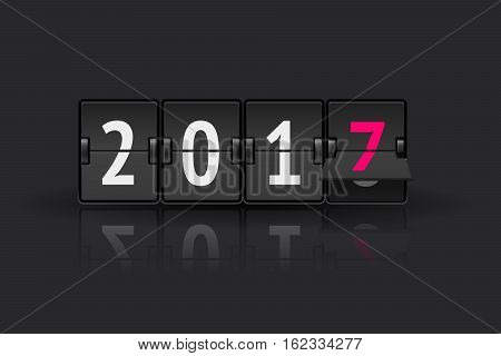 Flip board clock changing to 2017. New Year concept. Analog scoreboard flip calendar changes to another year. Digital countdown timer with 2017 numbers represents time going forward.