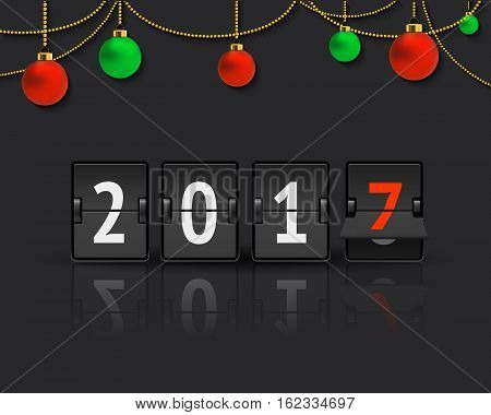 Flip board clock changing to 2017. Analog scoreboard flip calendar changes to another year. Digital countdown timer with numbers represents time going forward. New Year concept with christmas balls.