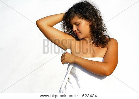 girl putting deodorant on