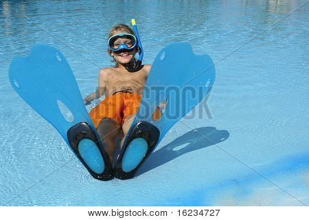 little boy peeping through his flippers