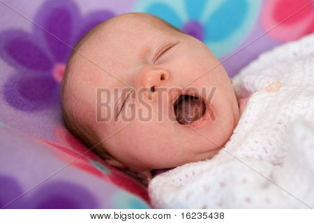 yawning baby girl