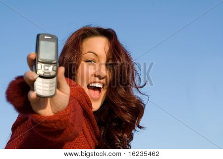 red head with cell phone