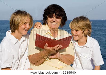 grandma reading to grandchildren