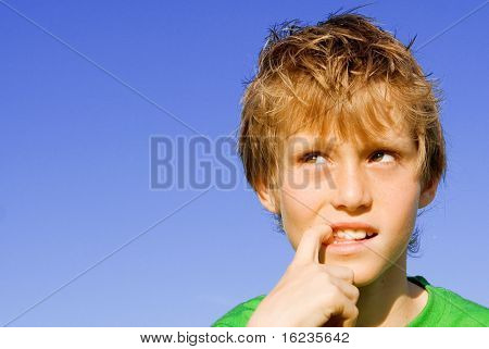 boy with puzzled look on face.