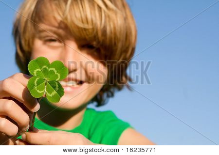 lucky four leaf clover boy FOCUS ON CLOVER.