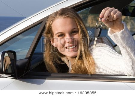 happy young woman with new car
