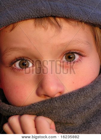 shy child with beautiful big eyes