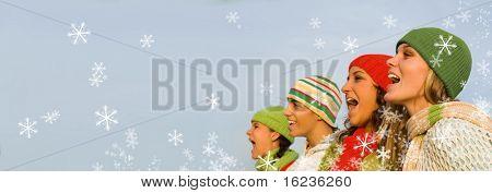 cantantes de villancicos de Navidad con nieve que cae