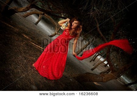 lost frightened woman in the woods ( fairy tale like) slight noise and soft focus